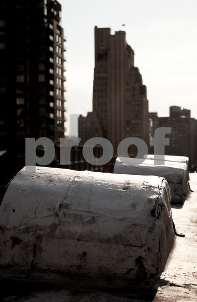 IMAGE: http://phlotography.smugmug.com/DRyan/New-York-City/Shots-From-The-Top/rooftops5/1178459642_VCyNk-L-4.jpg